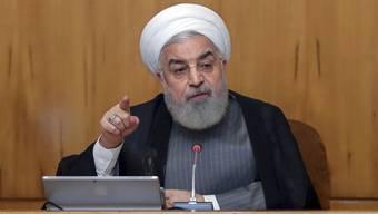 """Der iranische Präsident Hassan Ruhani kündigt bei einer Kabinettssitzung an, sein Land werde ab dem Wochenende """"unbegrenzt"""" Uran anreichern."""