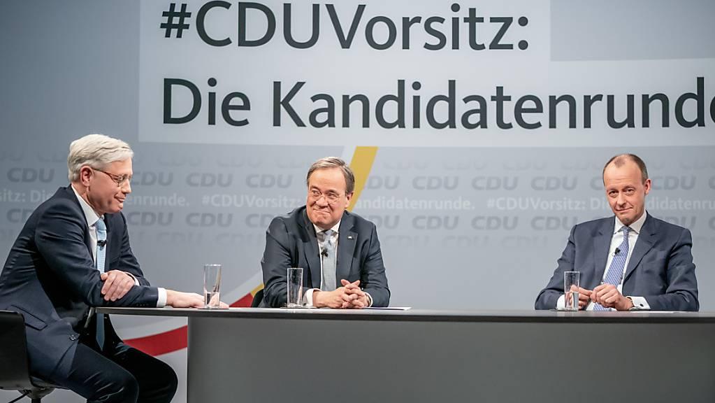 Die drei Kandidaten für den CDU-Parteivorsitz, Friedrich Merz (r-l), Armin Laschet und Norbert Röttgen. Foto: Michael Kappeler/dpa