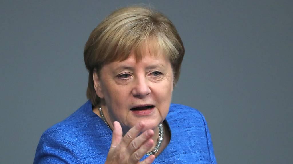 Merkel: Brauchen wirklichen Kraftakt für mehr Klimaschutz