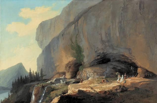 Die Entdeckung der Alpen: Caspar Wolf (1735–1783) war gleichzeitig ein wagemutiger Wegbereiter und malender Chronist des frühen Tourismus. «Die Beatushöhle mit Reisegesellschaft» von 1776.