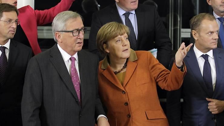 Die Gipfelteilnehmer, in der Mitte die deutsche Bundeskanzlerin Angela Merkel