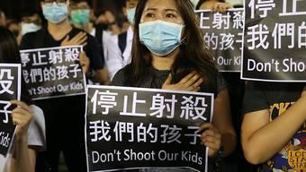 Soll als Vermummung verboten werden: Demonstration mit Atemschutzmasken in Hongkong.