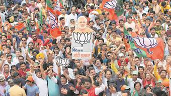 Unterstützer des Premierministers Narendra Modi und seiner Partei BJP bei einer Kundgebung in Neu-Delhi.