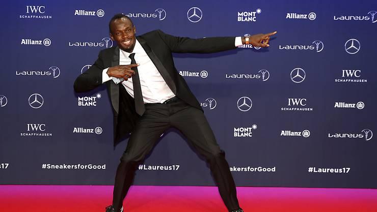 Usain Bolt bei der Ehrung in typischer Pose
