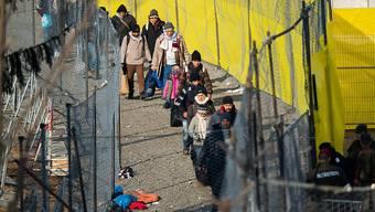 Flüchtlinge nach dem Grenzübertritt von Slowenien nach Österreich.