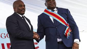 Kongos neuer Präsident Félix Tshisekedi (rechts) und sein Vorgänger Joseph Kabila (links) haben sich auf eine gemeinsame Regierung geeinigt. (Archivbild)