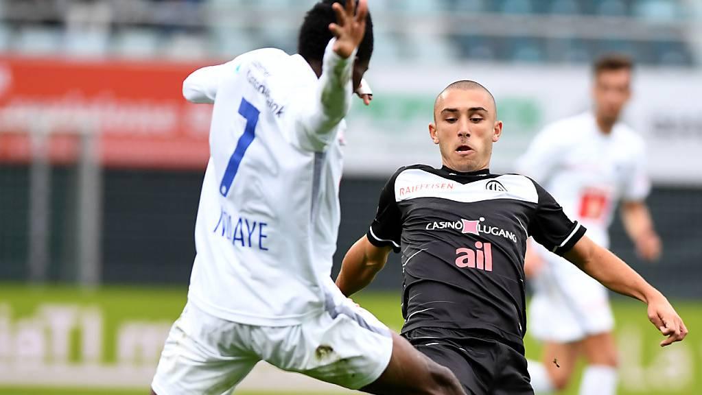 Luganos Nicola Dalmonte (rechts) gegen Ibrahima Ndiaye