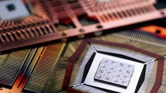 Konzentration der Computerchip-Hersteller: In der Branche kam es jüngst zu einer Reihe von Firmenfusionen. (Symbolbild)