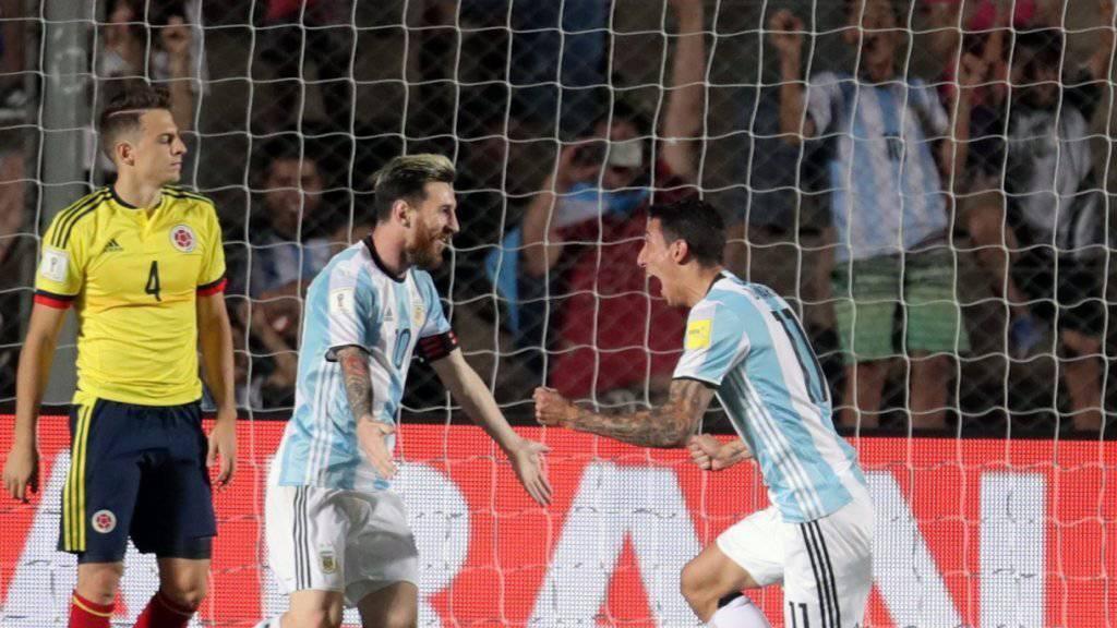 Lionel Messi (links) und Angel Di Maria bejubeln Argentiniens dritten Treffer