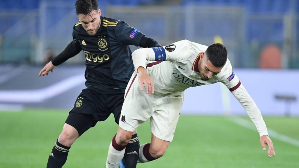 Harter Kampf im Stadio Olimpico: Romas Lorenzo Pellegrini (rechts) gegen den Ajaciden Nicolas Tagliafico