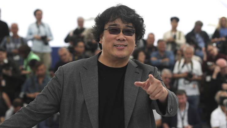 """Der Südkoreaner Bong Joon-ho erhält für seinen Film """"Parasite"""" die Goldene Palme von Cannes."""