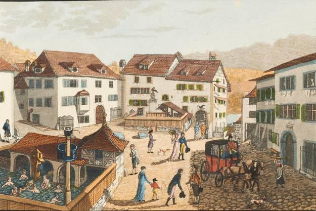 Der Kurplatz mit Verenabad (links) und Freibad: So sah der Maler Hans Ulrich Kern die öffentlichen Bäder unter freiem Himmel um 1800. Links der Staadhof, in der Mitte das Badgasthaus Raben, rechts die «Blume».Bild: Schweizerische Nationalbibliothek