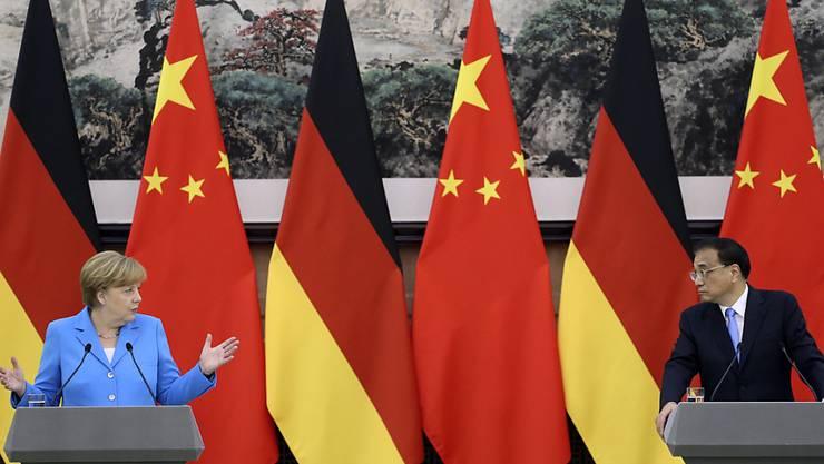 Wichtiges Thema bei Merkels China-Reise: Deutsche Unternehmen sind besorgt über mangelnde Datensicherheit und erzwungenen Technologietransfer.