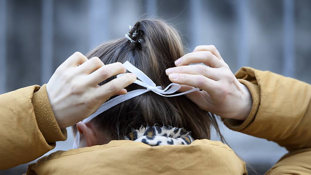 Gefangene nähen Schutzmasken in Belgien