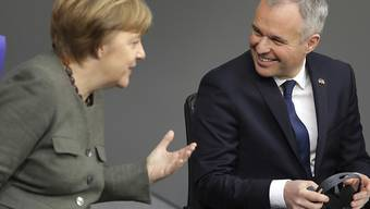 Die deutsche Bundeskanzlerin Angela Merkel und der französische Parlamentspräsident François de Rugy anlässlich der Feier zum 55. Jubiläum des Elysée-Vertrags im Reichstag in Berlin.