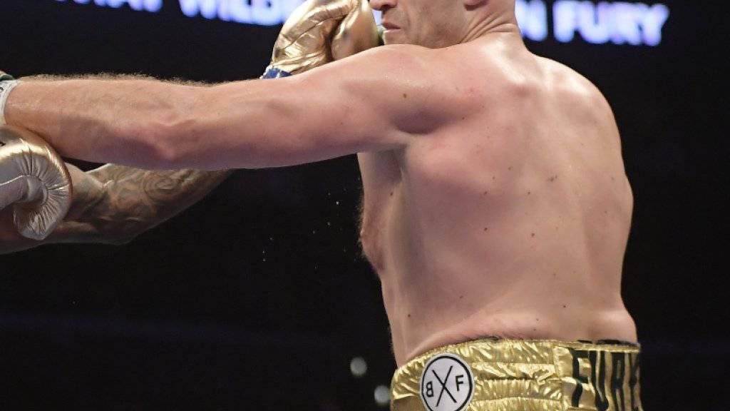 Tyson Fury (rechts) hat sich mit seinem starken Comeback und dem couragierten Auftritt gegen WBC-Champion Deontay Wilder (links) einen Top-TV-Vertrag in den USA erkämpft