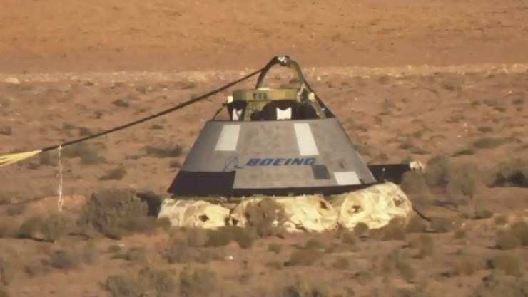"""Nach dem gescheiterten Testflug zur ISS ist die unbemannte Boeing-Raumkapsel """"Starliner"""" zur Erde zurückgekehrt.  (NASA via AP)"""