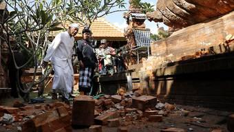Das jüngste Erdbeben vor der indonesischen Ferieninsel Bali führte unter anderem zu Schäden an einem Tempel.