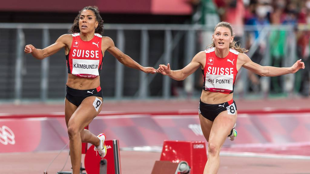 Ajla Del Ponte, right, and Mujinga Kambundji, left, finish the final of the women's 100 m in ranks five (Del Ponte) and six (Kambundji) at the 2020 Tokyo Summer Olympics Games in Tokyo, Japan, on Saturday, July 31, 2021.