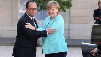 Angela Merkel und François Hollande gestern in Paris. ETIENNE LAURENT/Epa/Keystone