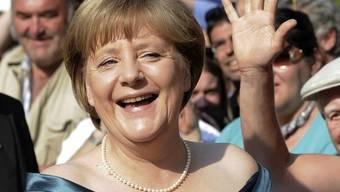 Angela Merkel amüsiert sich gut