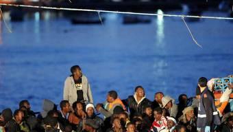 Flüchtlinge bei ihrer Ankunft in Lampedusa