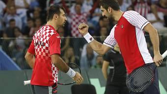 Sicherten Kroatien im Davis-Cup-Final gegen Argentinien im Doppel den zweiten Punkt: Ivan Dodig ((links) und Marin Cilic