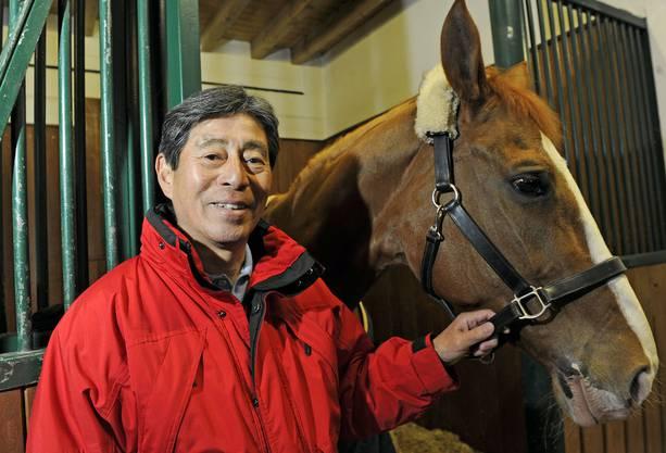 Hoketsu mit einem seiner Pferde.