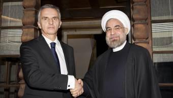 Didier Burkhalter (l) und Irans Präsident Hassan Ruhani in Davos