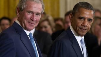 Die früheren Präsidenten George W. Bush (Links) und Barack Obama sind besorgt über die politische Kultur in den USA. (Archivbild)
