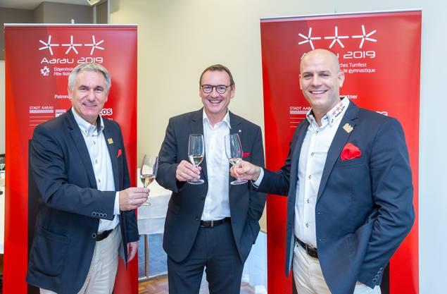 Sportdirektor Alex Hürzeler, Erwin Grossenbacher und Stefan Riner (v.l.) freuen sich über den erfolgreichen Abschluss des Eidgenössischen Turnfests.