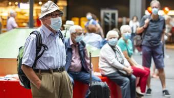 Die Maskenpflicht im öffentlichen Verkehr dürfte noch eine Weile Bestand haben.