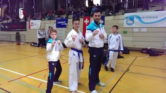 Erfolgreiche Baseler von links nach rechts: Eric Timmer, Luca Spitz und ihr Trainer Murat Sahin.