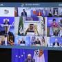 Charles Michel, Präsident des Europäischen Rats (unten), nimmt am virtuellen G20-Gipfel unter Vorsitz Saudi-Arabiens teil. Eigentlich sollte der Gipfel erstmals in der saudischen Hauptstadt Riad stattfinden. Wegen der Corona-Pandemie werden die Gespräche aber nur per Video-Schalte geführt. Foto: Yves Herman/Pool Reuters/AP/dpa