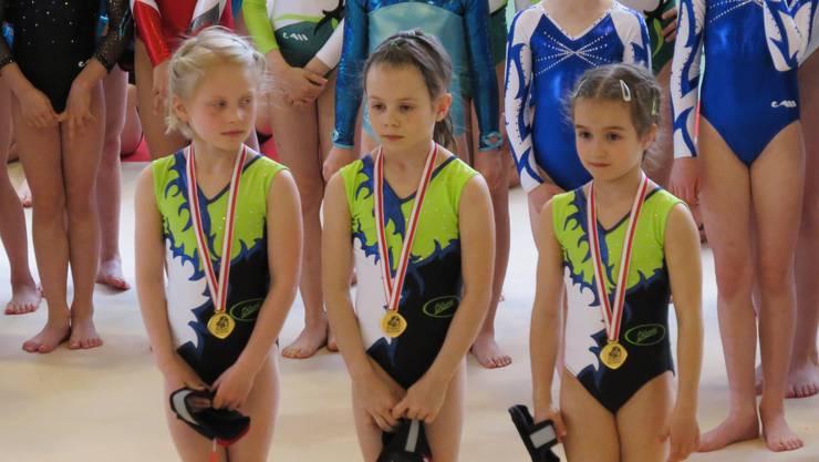 Konzentrierte Siegerinnen (v.l.n.r.): Aline Hug, Corina Erdin und Chiara Giubellini erhielten Gold in der Mannschaftswertung.
