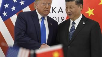 China unter der Führung von Staatschef Xi Jinping hat am Sonntag mit den USA gleichgezogen und die angedrohte Erhöhung von Strafzöllen vorerst ausgesetzt. (Archivbild)