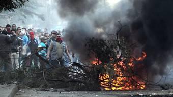 Anhänger des abgesetzten Präsidenten Mursi bauen Strassensperren