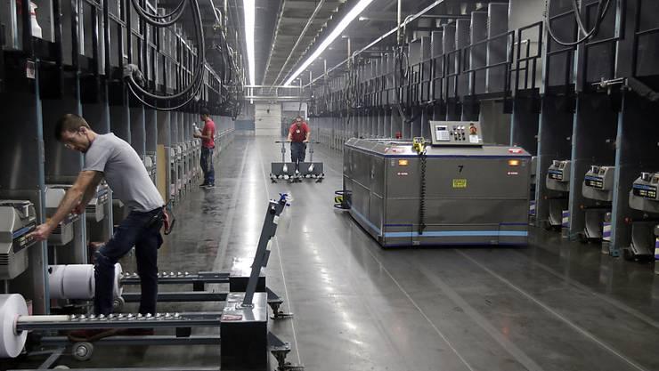 Teilautomatisierte Recyclingfabrik in den USA: Neun Prozent der Arbeitsplätze in den OECD-Ländern könnten in den kommenden Jahren automatisiert werden. Weitere 25 Prozent könnten sich massiv ändern.