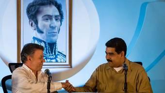 Einigen sich im Grenzstreit: Venezuelas Präsident Maduro (rechts) und sein kolumbianischer Amtskollege Juan Manuel Santos.