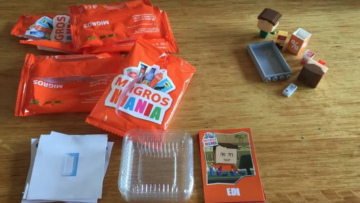 Bei der Migros erhalten die Kunden Lego-ähnliche Bausteine, bei der Coop waren es Saugnapf-Emojis.