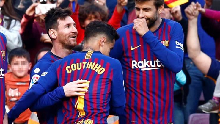Lionel Messi, Philippe Coutinho und Gerard Piqué freuen sich über einen weiteren Sieg