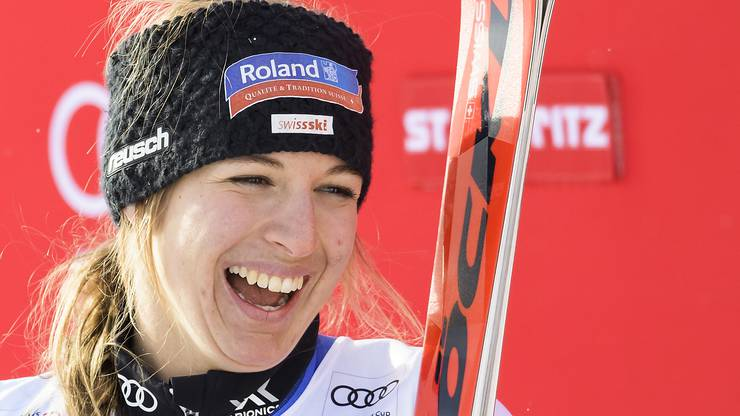 Winner Jasmine Flury of Switzerland reacts during the podium ceremony after the women's super-G race at the Alpine skiing World Cup, in St. Moritz, Switzerland, Saturday, Dec. 9, 2017. (Jean-Christophe Bott/Keystone via AP)