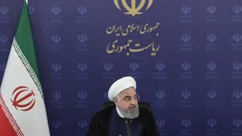 HANDOUT - Hassan Ruhani, Präsident vom Iran, leitet eine Sitzung des Nationalkomitees. Foto: -/Iranian Presidency/dpa - ACHTUNG: Nur zur redaktionellen Verwendung im Zusammenhang mit der aktuellen Berichterstattung und nur mit vollständiger Nennung des vorstehenden Credits