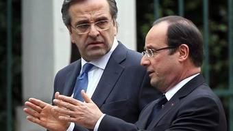 Der französische Präsident Hollande gibt dem griechischen Regierungschef Samaras in Athen die Richtung vor