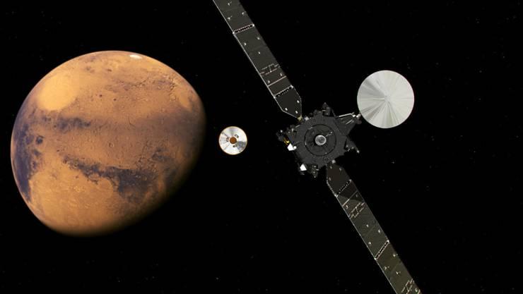 """""""Schiaparelli"""" vor der Explosion bei der Landung auf dem Mars - Abkoppelung von der Muttersonde. (künstlerische Darstellung durch die ESA)"""
