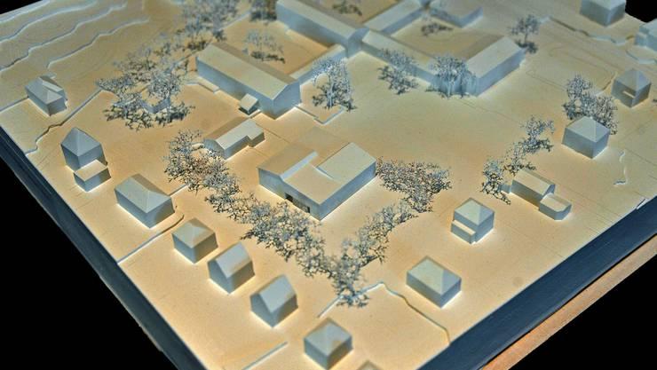 Der Neubau (in der Bildmitte) ist als eigenständiger Baukörper konzipiert.