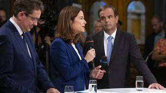 Die Spitzenvertreter von drei Bundesratsparteien (v.l.n.r. Albert Rösti, SVP, Petra Gössi, FDP, und Gerhard Pfister, CVP) während der Elefantenrunde der Parteipräsidenten in Bundeshaus in Bern.  Die Grünen werden bei nächster Gelegenheit Anspruch auf einen Sitz im Bundesrat geltend machen.