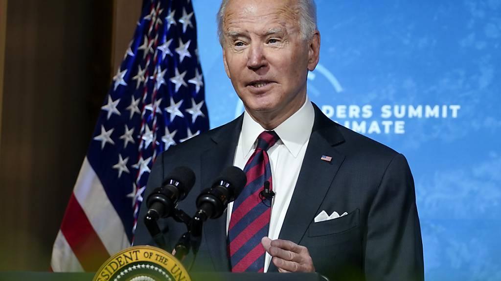 Joe Biden, US-Präsident, spricht beim virtuellen Klima-Gipfel, zu dem er dutzende Staats- und Regierungschefs eingeladen hat, im East Room des Weißen Hauses. Foto: Evan Vucci/AP/dpa