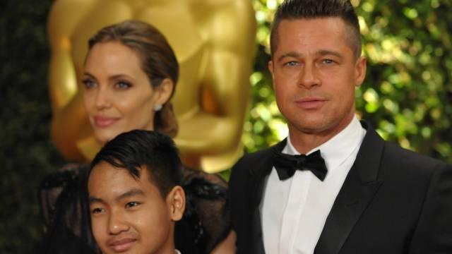 Angelina Jolie, Maddox Jolie-Pitt und Brad Pitt (Archiv)