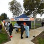 A person receives a COVID-19 test at a Coronavirus pop-up testing facility in Broadmeadows, Melbourne, Friday, June 26, 2020. Coronavirus pop-up testing facilities have been setup in residential streets throughout area's considered coronavirus hotspots following a spike in cases.  (AAP Image/James Ross) NO ARCHIVING